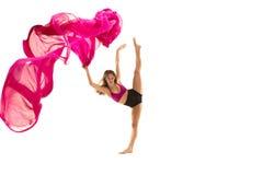 ballerina Junges würdevolles weibliches Balletttänzertanzen über weißem Studio Schönheit des klassischen Balletts stockfoto