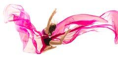 ballerina Junges würdevolles weibliches Balletttänzertanzen über weißem Studio Schönheit des klassischen Balletts stockfotos