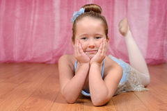 Ballerina laying on the stage Royalty Free Stock Images