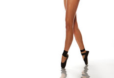 Ballerina legs. In point shoes over white Royalty Free Stock Photo