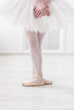 Ballerina legs closeup in third position. Ballerina legs third position in pointe, ballet dancer closeup background, vertical image royalty free stock photo