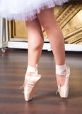 Ballerina legs in pointes on dancing hall Stock Photo