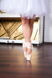 Ballerina legs in pointes on dancing hall Stock Image