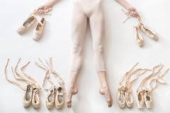 Ballerina lies in studio Royalty Free Stock Image