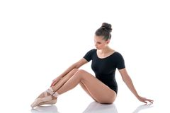Ballerina looking at her slender legs in pointes. Image of ballerina looking at her slender legs in pointes Stock Images