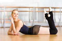 Ballerina lying with her legs up on the floor Royalty Free Stock Photos