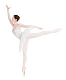 Ballerina makes ballet position arabesque isolated on white background Stock Images