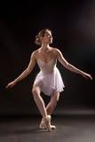 Ballerina makes courtesy Royalty Free Stock Photo