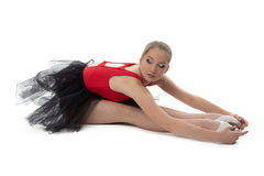 Ballerina makes stretching exercises Stock Photos