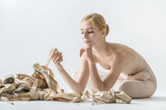 Ballerina with many pointe shoes Stock Images