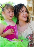 Ballerina and Mother. A cute young girl in costume ready for her ballet performance posing with her mother stock image