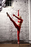Ballerina in motion. Beautiful young ballerine in red in motion Royalty Free Stock Image