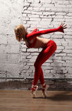 Ballerina in motion. Beautiful young ballerine in red in motion Royalty Free Stock Photos