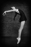 Ballerina On Grunge Brick Background Royalty Free Stock Images