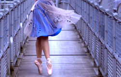 Ballerina on pedestrian bridge Royalty Free Stock Photos