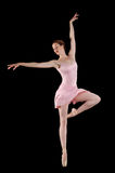Ballerina performing. Against a black background Stock Image