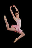 Ballerina performing. Against a black background Royalty Free Stock Photography
