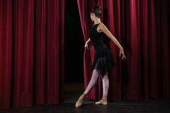 Ballerina performing ballet dance on stage. In theatre royalty free stock images