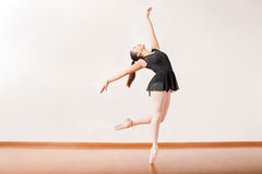Ballerina performing in a dance studio Stock Photography