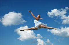 Ballerina performing a jump Stock Photo
