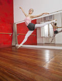 Ballerina Performing Split In Dance Studio Royalty Free Stock Photography