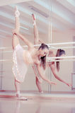 Ballerina in pink dress аgainst studio Royalty Free Stock Photos