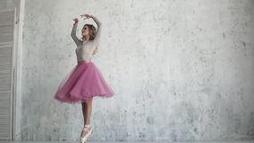Ballerina is spinning on toes in pointe shoes. beautiful young ballet dancer. pirouette in slow motion. Ballerina in a pink tutu and pointe shoes. beautiful stock video