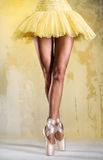 Ballerina. On point over obsolete wall Stock Image