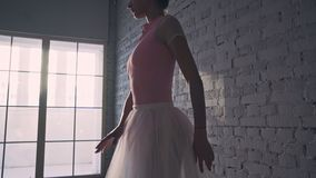 Ballerina on the pointe. Close up. Young ballerina dancing in the hall stock video footage