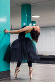Ballerina on pointe looks up in the subway Stock Image