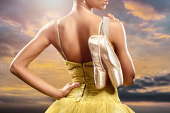 Ballerina. With pointe shoes against obsolete wall background Stock Photography