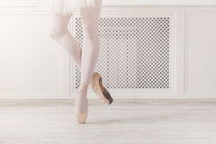 Ballerina in pointe shoes, graceful legs, ballet background Royalty Free Stock Images
