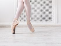 Ballerina in pointe shoes, graceful legs, ballet background. Ballerina legs on pointe, ballet dancer concept background Royalty Free Stock Photo