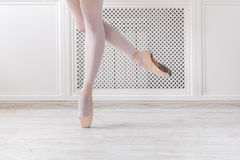 Ballerina in pointe shoes, graceful legs, ballet background. Ballerina legs on pointe, ballet dancer concept background Stock Photography