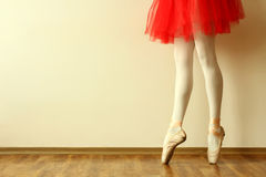 Ballerina. In Pointe on a wooden floor Royalty Free Stock Photo