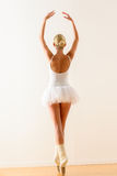 Ballerina pose from behind dancing in studio Stock Photos