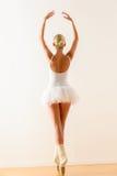 Ballerina pose from behind dancing in studio Stock Photos