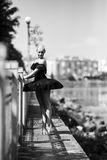 Ballerina posing on a background of the lake Royalty Free Stock Photo