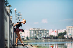 Ballerina posing on a background of the lake Stock Photography