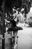 Ballerina posing in the center city Stock Photo