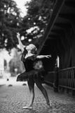 Ballerina posing in the center city royalty free stock image