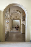 Ballerina posing in interior Royalty Free Stock Image