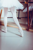 Ballerina posing. Reflection in the mirror on the background, ballet shoes Stock Photos