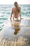 Ballerina posing on seafront Stock Photos