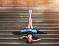 Ballerina posing  on the stairs. Ballerina out of doors, young modern ballet dancer posing  on the stairs Royalty Free Stock Images
