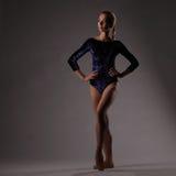 Ballerina posing, studio background. slim girl royalty free stock photo