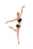 Ballerina posing in studio on white background Stock Photography