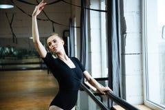 Ballerina practicing in ballet class Stock Image