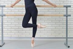 Ballerina practicing ballet at dance studio near barre. stock photo