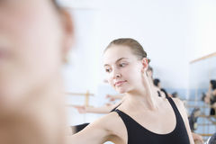 Ballerina Practicing With Classmates Royalty Free Stock Images